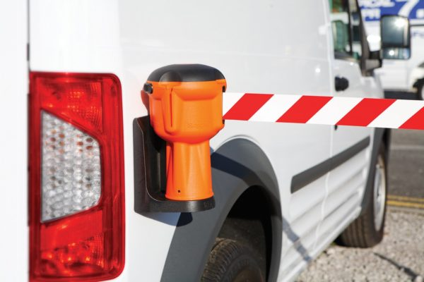 retractable barrier attached to vehicle