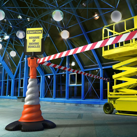 health and safety signs with retractable belt barrier and road cone